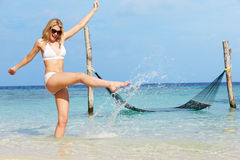 Woman In Bikini Splashing In Beautiful Tropical Sea Royalty Free Stock Photography