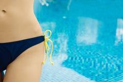 Woman In Bikini Standing Against swiming pool Stock Images