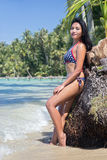 Woman in bikini standing on the beach Royalty Free Stock Photos