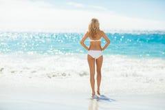Woman in bikini standing on beach Royalty Free Stock Photo