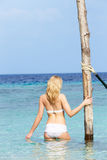 Woman In Bikini Standing In Beautiful Tropical Sea Stock Photography