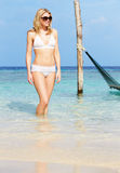 Woman In Bikini Standing In Beautiful Tropical Sea Stock Images
