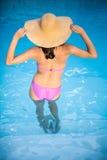 Woman in bikini standing in swimming pool Stock Photography