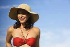 Woman in bikini and straw hat. royalty free stock photography
