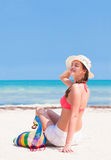 Woman in bikini and straw hat with beach bag Royalty Free Stock Photos