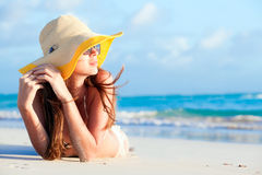 Woman in bikini and straw hat lying on tropical Royalty Free Stock Image