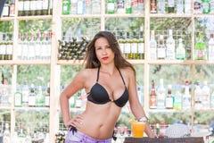 Woman in bikini at the summer beach bar stock images
