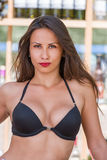 Woman in bikini at the summer beach bar royalty free stock images