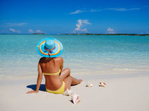 Woman in bikini sunbathing on the beach in Exuma, Bahamas Stock Image