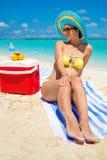 Woman in bikini sunbathing on the beach in Exuma, Bahamas Royalty Free Stock Photos