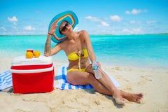 Woman in bikini sunbathing on the beach in Exuma, Bahamas Royalty Free Stock Photography