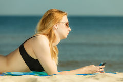 Woman in bikini sunbathing and relaxing on beach Stock Image