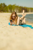 Woman in bikini sunbathing and relaxing on beach Royalty Free Stock Photo