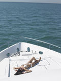Woman In Bikini Sunbathing On Yacht Royalty Free Stock Image