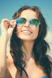 Woman in bikini and sunglasses Royalty Free Stock Photos