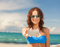 Woman in bikini and sunglasses Royalty Free Stock Images