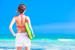 Woman in bikini and sunglasses with beach bag Stock Image