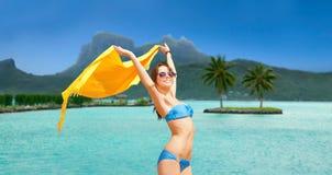 Woman in bikini and sunglasses on bora bora beach Stock Photography