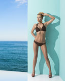 Woman in bikini with sunglasses on the head. Sexy blonde girl in bikini with sunglasse and heels, she looks at right and takes her sunglasses on the head Stock Images