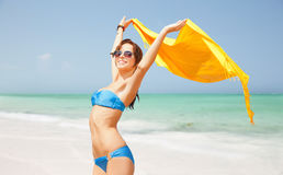 Woman in bikini and sunglasses with pareo on beach Royalty Free Stock Image