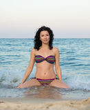 Woman in bikini in the surf Royalty Free Stock Photography