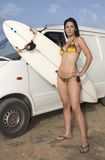 Woman in bikini with surfboard Stock Image