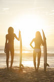 Woman Bikini Surfer Girls & Surfboards Sunset Beach Stock Photo