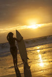 Woman Bikini Surfer & Surfboard Sunset Beach Royalty Free Stock Image