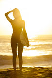 Woman Bikini Surfer & Surfboard Sunset Beach Stock Photos