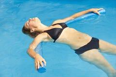 Woman in bikini in swimming pool stock photos