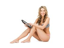 Woman in bikini with tablet pc computer Royalty Free Stock Image