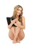 Woman in bikini with tablet pc computer Stock Photography