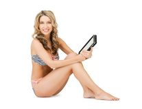 Woman in bikini with tablet pc computer Royalty Free Stock Images