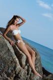 Woman in bikini on the tropical beach. Beautiful woman in bikini on the tropical beach Royalty Free Stock Images
