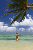 Woman in a bikini at a tropical beach Royalty Free Stock Photo