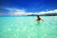 Woman in bikini at tropical beach royalty free stock photography