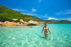 Woman in bikini at tropical beach stock photos