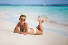 Woman in bikini at tropical beach. Stock Photo
