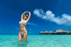 Woman in bikini at tropical beach Royalty Free Stock Photos