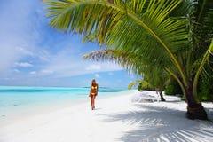 Woman in bikini under palm Royalty Free Stock Photography