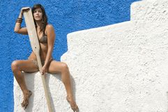 Woman in bikini waiting for her boat. With oars Stock Photos