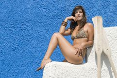 Woman in bikini waiting for her boat. With oars Royalty Free Stock Photo