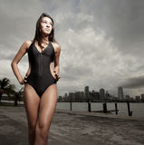 Woman in a bikini walking Stock Images