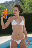 Woman in bikini with water gun Royalty Free Stock Photo