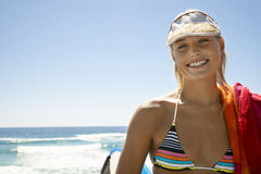 Woman In Bikini Wearing Visor Cap At Beach. Portrait of beautiful young woman in bikini wearing visor cap at beach Stock Photos