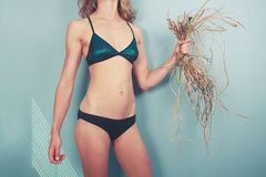 Woman in bikini with weed Stock Images