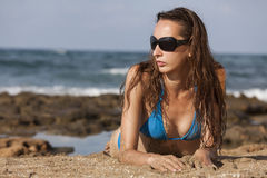 Woman in bikinis on the beach Royalty Free Stock Image