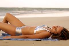 Woman in bikinis sunbathing Royalty Free Stock Photos