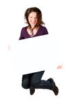 Woman with billboard jump. Smiling woman holding blank billboard and jumping royalty free stock image
