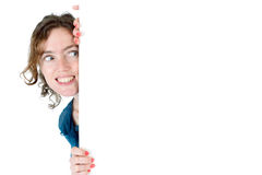 Woman billboard peeping Royalty Free Stock Photography